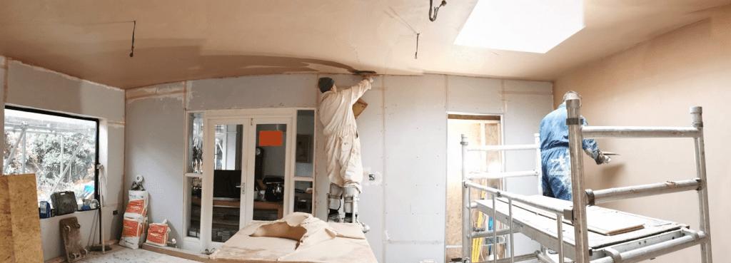 plasterer working the room